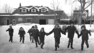 Children playing in front of Broadview Village Children's Home