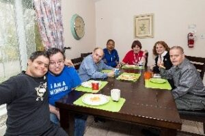 Group of residents around dining table