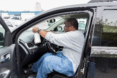 Participant cleaning a car interior