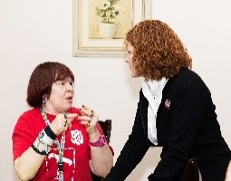 Major Christine visiting a resident