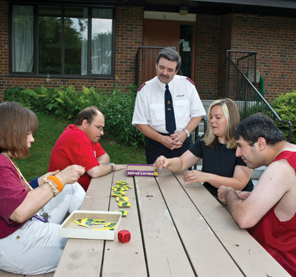 Group of residents playing game at picnic table