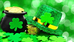 Four leaf clovers, green hat and pot of gold