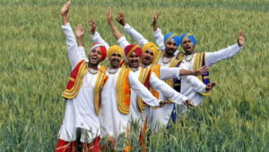 6 Indian men dancing in a field