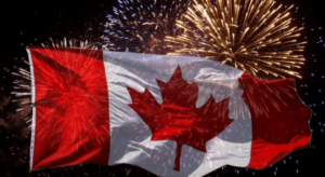 Canadian flag with fireworks behind it
