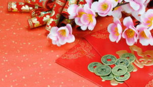 Chinese firecrackers, coins, and flowers