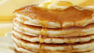 Pile of pancakes with butter and syrup